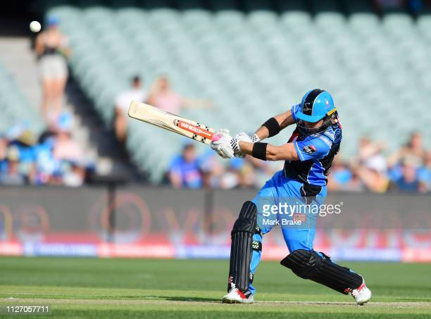 Alex Carey of the Adelaide Strikers bats and hits 6 during the Big Bash League match between the Adelaide Strikers and the Brisbane Heat at Adelaide...