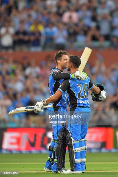 Alex Carey of the Adelaide Strikers celebrates with Jake Weathered of the Adelaide Strikers after reaching his century during the Big Bash League...
