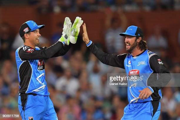 Alex Carey of the Adelaide Strikers celebrates with Jono Dean of the Adelaide Strikers during the Big Bash League match between the Adelaide Strikers...