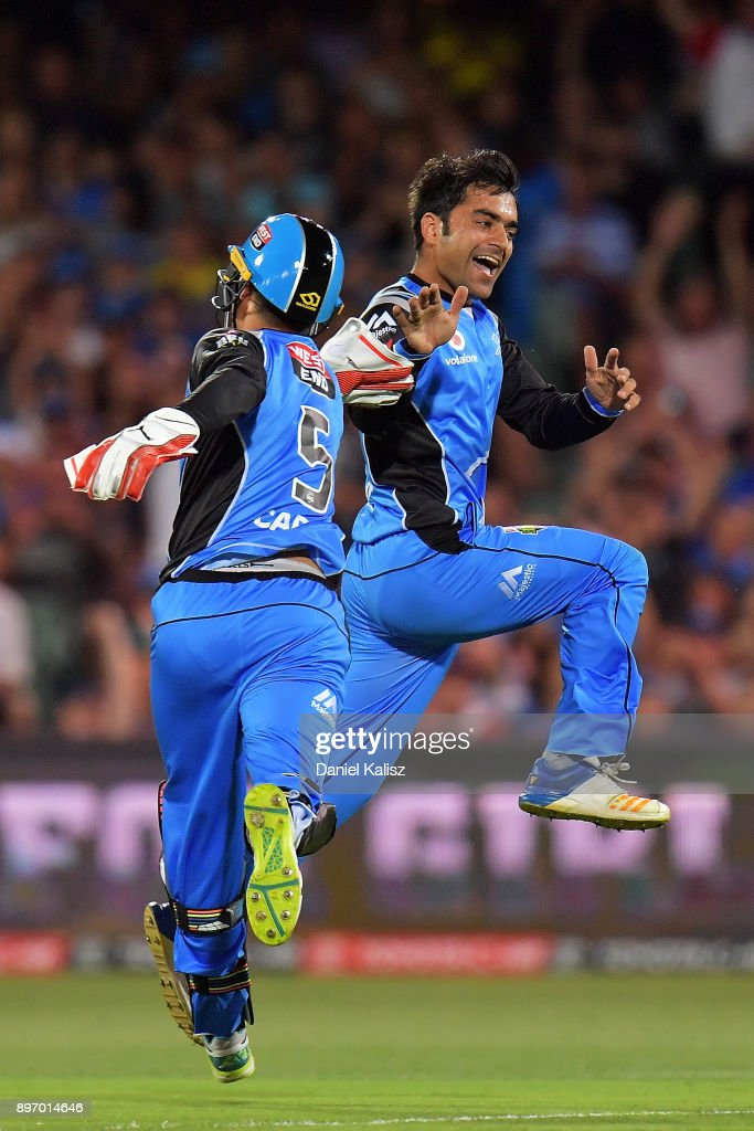 Alex Carey of the Adelaide Strikers celebrates with Rashid Khan of the Adelaide Strikers after bowling out Ben Rohrer of the Sydney Thunder during the Big Bash League match between the Adelaide Strikers and the Sydney Thunder at Adelaide Oval on December 22, 2017 in Adelaide, Australia.