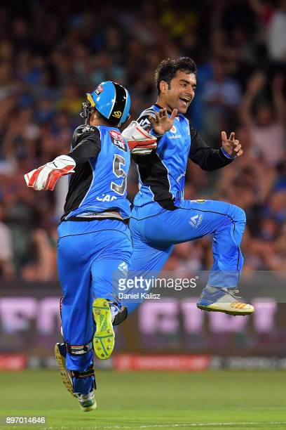 Alex Carey of the Adelaide Strikers celebrates with Rashid Khan of the Adelaide Strikers after bowling out Ben Rohrer of the Sydney Thunder during...