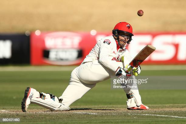 Alex Carey of the Redbacks plays a sweep shot during the Sheffield Shield final between Victoria and South Australia on March 30 2017 in Alice...