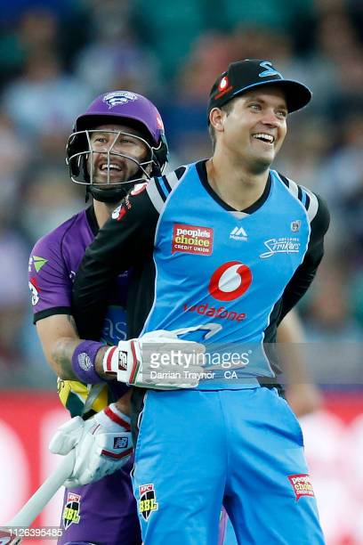 Alex Carey of the Strikers and Matthew Wade of the Hobart Hurricanes share a laugh after colliding during the Big Bash League match between the...