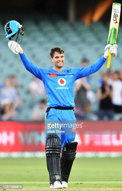 Alex Carey of the Strikers celebrates bringing up his century during the Big Bash League match between the Adelaide Strikers and the Brisbane Heat at...
