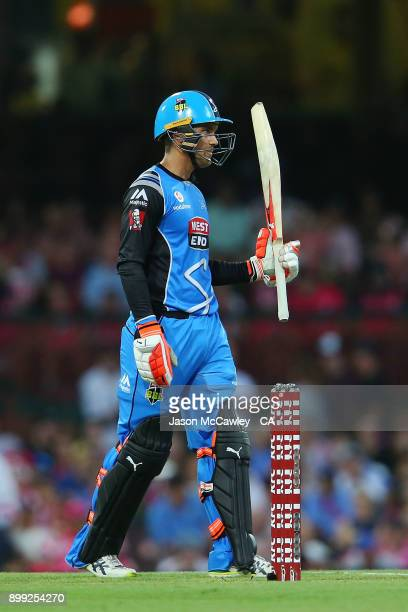Alex Carey of the Strikers /celebrates his half century during the Big Bash League match between the Sydney Sixers and the Adelaide Strikers at...