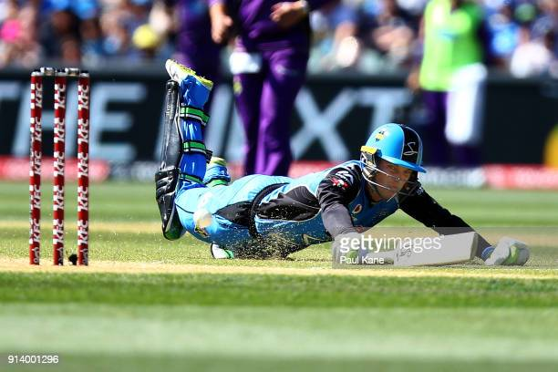 Alex Carey of the Strikers dives to avoid a runout during the Big Bash League Final match between the Adelaide Strikers and the Hobart Hurricanes at...