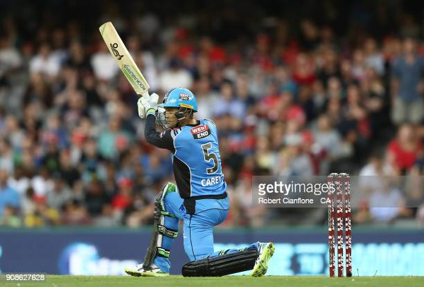 Alex Carey of the Strikers hits out during the Big Bash League match between the Melbourne Renegades and the Adelaide Strikers at Etihad Stadium on...