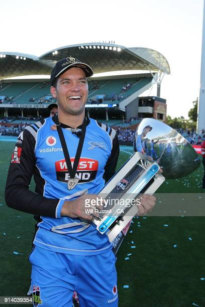Alex Carey of the Strikers holds the trophy after defeating the Hurricanes during the Big Bash League Final match between the Adelaide Strikers and...