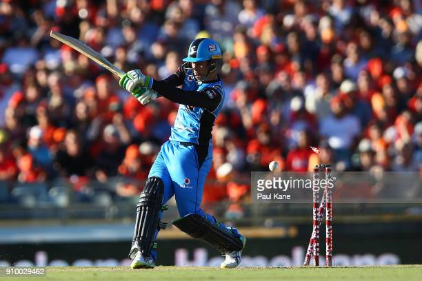 Alex Carey of the Strikers is bowled by Jhye Richardson of the Scorchers during the Big Bash League match between the Perth Scorchers and the...