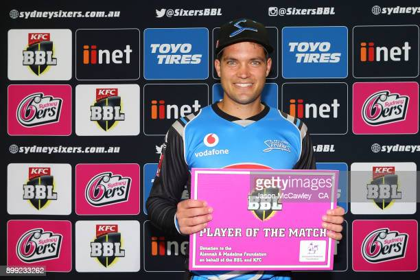 Alex Carey of the Strikers poses with his player of the match award after the Big Bash League match between the Sydney Sixers and the Adelaide...