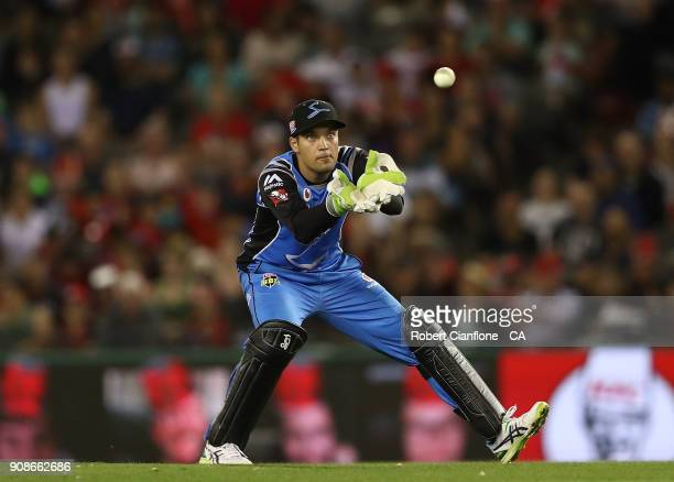 Alex Carey of the Strikers takes the ball during the Big Bash League match between the Melbourne Renegades and the Adelaide Strikers at Etihad...