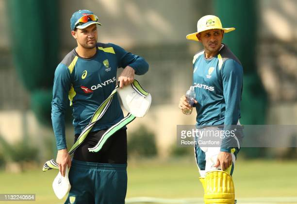 Alex Carey speaks with Usman Khawaja of Australia during an Australian training session ahead of game two of the T20I Series between India and...