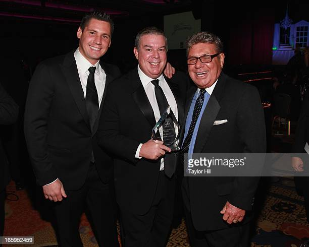 Alex Carr Elvis Duran and Johnny Pool attend the 27th Annual Night Of A Thousand Gowns at the Hilton New York on April 6 2013 in New York City