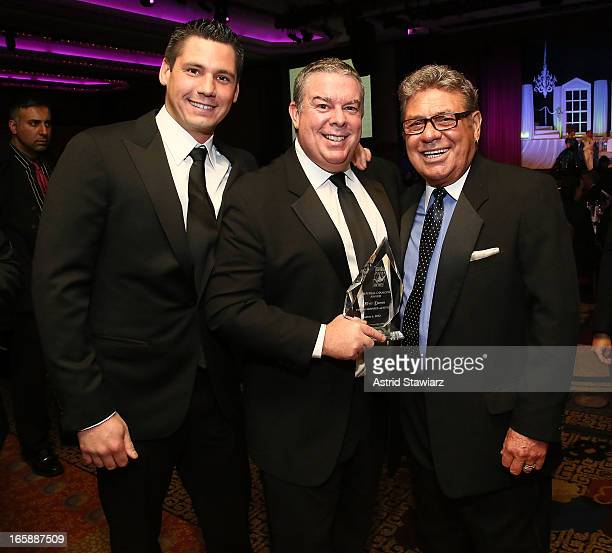 Alex Carr Elvis Duran and Uncle Johnny pose with the Imperial Diamond Award at the 27th Annual Night Of A Thousand Gowns at the Hilton New York on...