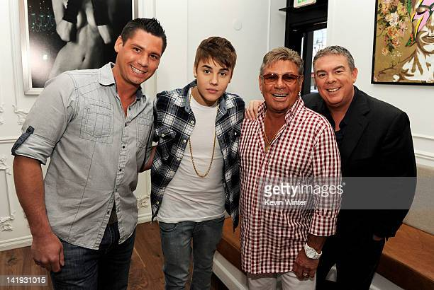 Alex Carr singer Justin Bieber Johnny Pool and radio host Elvis Duran pose after Biebers interview with Elvis Duran for The Elvis Duran Morning Show...