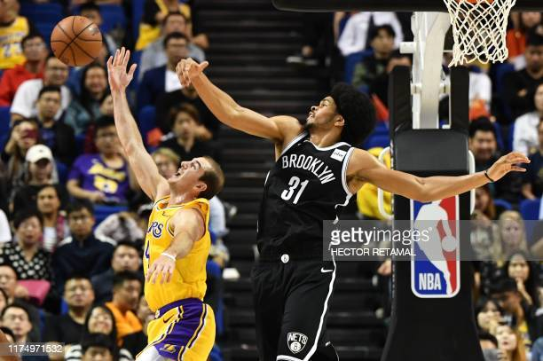 Alex Caruso of the Los Angeles Lakers and Jarrett Allen of Brooklyn Nets compite for the ball during the National Basketball Association preseason...