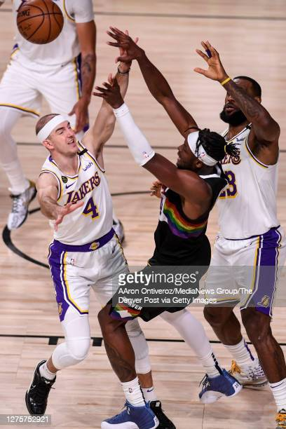 Alex Caruso of the Los Angeles Lakers and LeBron James mob Jerami Grant of the Denver Nuggets during the fourth quarter of Denver's 114106 win at...