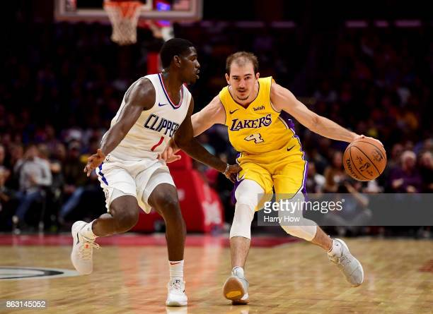 Alex Caruso of the Los Angeles Lakers dribbles up court against Jawun Evans of the LA Clippers at Staples Center on October 10 2017 in Los Angeles...
