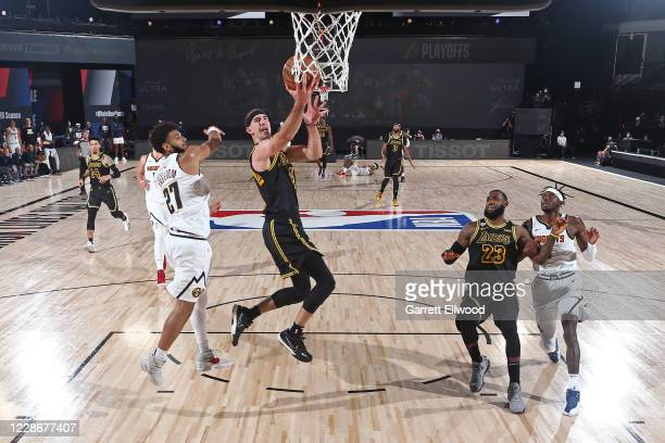 Alex Caruso of the Los Angeles Lakers drives to the basket against the Denver Nuggets during Game Two of the Western Conference Finals on September...