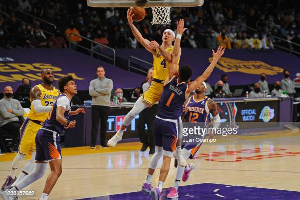 Alex Caruso of the Los Angeles Lakers drives to the basket against the Phoenix Suns during Round 1, Game 3 of the 2021 NBA Playoffs on May 27, 2021...