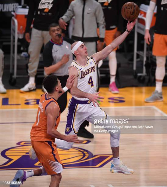 Alex Caruso of the Los Angeles Lakers drives to the basket against the Phoenix Suns in the first half of game four of the Western Conference First...