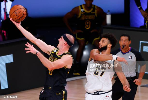 Alex Caruso of the Los Angeles Lakers drives to the basket against Jamal Murray of the Denver Nuggets during the second quarter in Game Two of the...