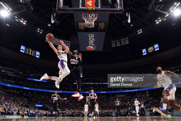 Alex Caruso of the Los Angeles Lakers drives to the basket during the game against the Denver Nuggets on December 3 2019 at the Pepsi Center in...