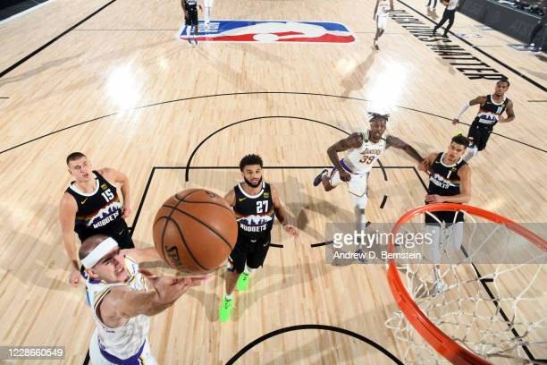 Alex Caruso of the Los Angeles Lakers drives to the basket during the game against the Denver Nuggets during Game Three of the Western Conference...
