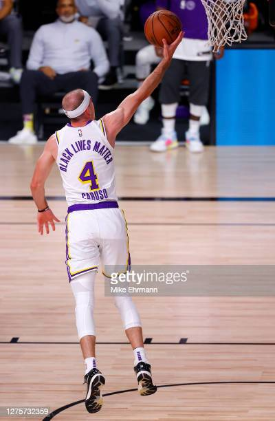 Alex Caruso of the Los Angeles Lakers drives to the basket during the second quarter against the Denver Nuggets in Game Three of the Western...