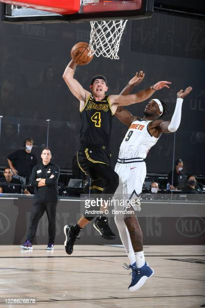 Alex Caruso of the Los Angeles Lakers dunks the ball against the Denver Nuggets during Game Two of the Western Conference Finals of the NBA Playoffs...