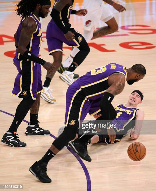 Alex Caruso of the Los Angeles Lakers falls to the court after colliding with LeBron James during a 102-93 win over the Portland Trail Blazers at...