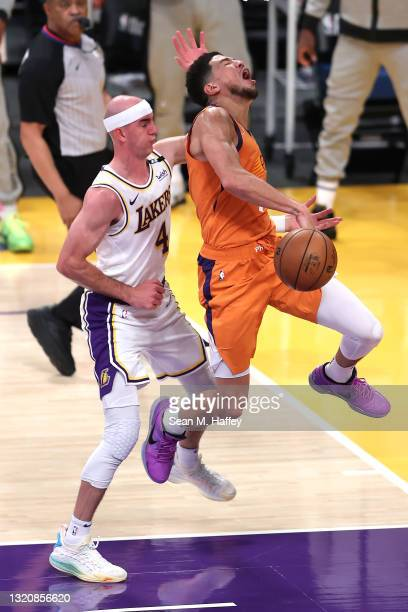 Alex Caruso of the Los Angeles Lakers fouls Devin Booker of the Phoenix Suns during the second half of Game Four of the Western Conference...