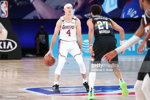Alex Caruso of the Los Angeles Lakers handles the ball against the Denver Nuggets during Game Three of the Western Conference Finals on September 22...