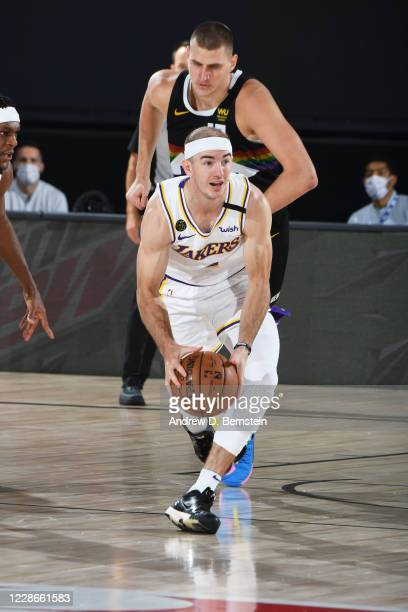 Alex Caruso of the Los Angeles Lakers handles the ball during the game against the Denver Nuggets during Game Three of the Western Conference Finals...