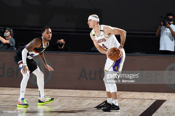 Alex Caruso of the Los Angeles Lakers handles the ball while Monte Morris of the Denver Nuggets plays defense during Game Three of the Western...