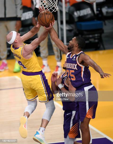 Alex Caruso of the Los Angeles Lakers has his shot blocked by Mikal Bridges of the Phoenix Suns in the second quarter during game six of the Western...