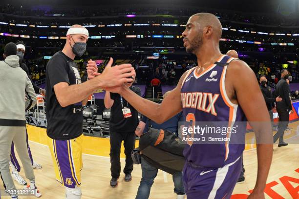 Alex Caruso of the Los Angeles Lakers high fives Chris Paul of the Phoenix Suns after the game during Round 1, Game 6 of the 2021 NBA Playoffs on...
