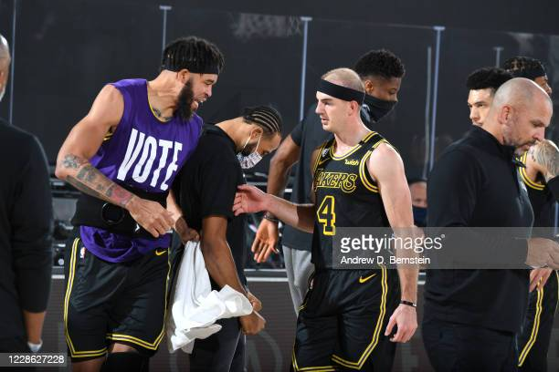 Alex Caruso of the Los Angeles Lakers highfives teammates during Game Two of the Western Conference Finals of the NBA Playoffs on September 20 2020...