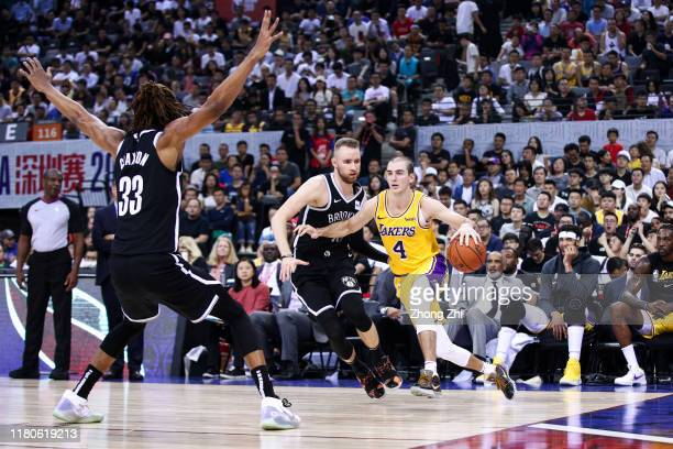Alex Caruso of the Los Angeles Lakers in action during the match against Dzanan Musa and Nicolas Claxton of the Brooklyn Nets during a preseason game...