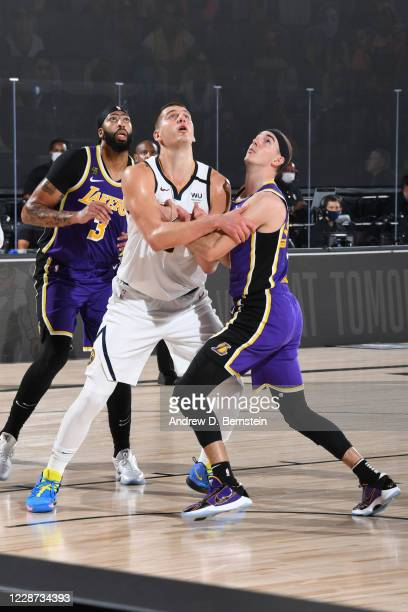 Alex Caruso of the Los Angeles Lakers plays defense against Nikola Jokic of the Denver Nuggets during Game Five of the Western Conference Finals on...