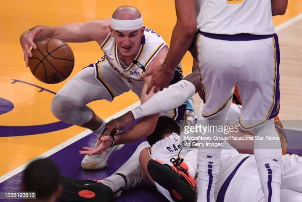Alex Caruso of the Los Angeles Lakers scrambles for the loose ball against the Phoenix Suns in the first half of game four of the Western Conference...