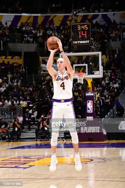 Alex Caruso of the Los Angeles Lakers shoots a three point basket during the game against the Phoenix Suns during Round 1, Game 4 of the 2021 NBA...