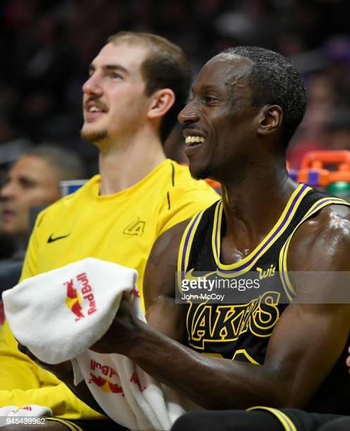 Alex Caruso of the Los Angeles Lakers sits next to Andre Ingram of the Los Angeles Lakers in the second half against the Los Angeles Clippers at...
