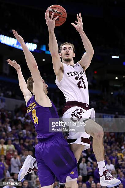 Alex Caruso of the Texas A&M Aggies makes the basket and draws the foul late in the second half against Paul Jesperson of the Northern Iowa Panthers...