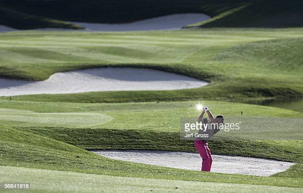 Alex Cejka of Germany hits out of a bunker on the eighteenth hole during the fourth round of the Bob Hope Chrysler Classic at the Classic Club on...