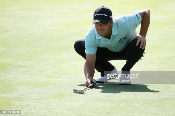 Alex Cejka of Germany lines up a putt on the 18th green during the third round of the Barracuda Championship at Montreux Country Club on August 4...