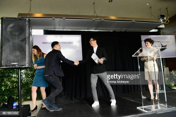 Alex Chi accepts the Kiehl's Someone to Watch Award on behalf of Justin Chon from John Cho and Alia Shawkat onstage at the Film Independent Spirit...
