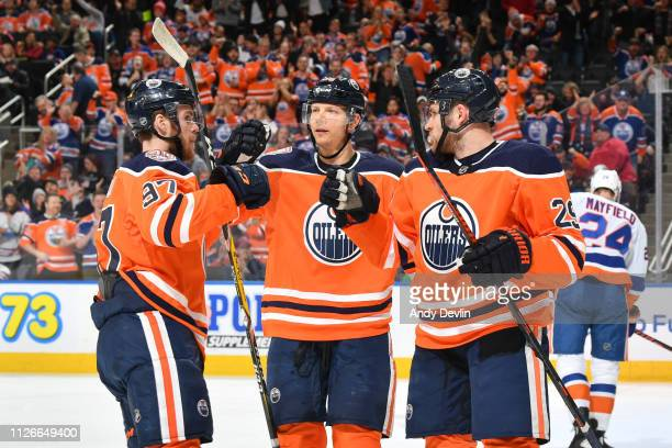 Alex Chiasson Connor McDavid and Leon Draisaitl of the Edmonton Oilers celebrate after a goal during the game against the New York Islanders on...