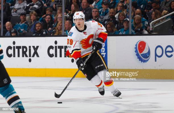 Alex Chiasson fo the Calgary Flames skates with the puck against the San Jose Sharks at SAP Center on April 8 2017 in San Jose California