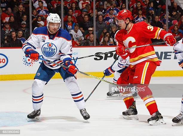 Alex Chiasson of the Calgary Flames battles against Andrej Sekera of the Edmonton Oilers at Scotiabank Saddledome on January 21 2017 in Calgary...